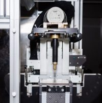 X-ray tube mounted on rotating gantry with collimator attached